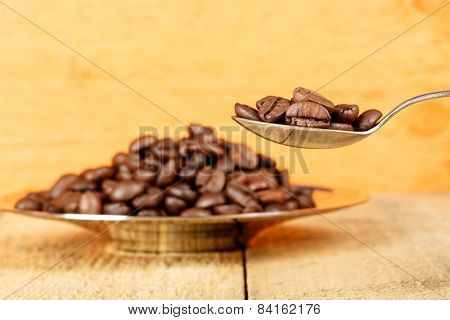Coffee Beans In A Spoon