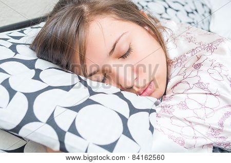 cute young girl sleeping hugging pillow