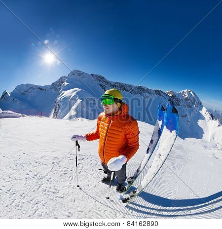 Guy with ski near in snow during sunny winter day