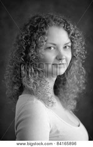 Smiling Fairy Woman With Curly Hair, Big Breast, Low Neck Decollete On Dark Grey Background Black&wh