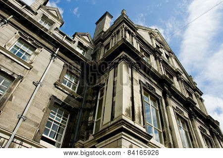 A Building At Trinity College Campus In Dublin Ireland, View From The Ground