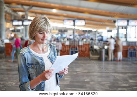 Woman with backpack going on boarding