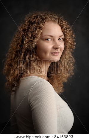 Smiling Fairy Woman With Red Curly Hair, Big Breast On Dark Grey Background