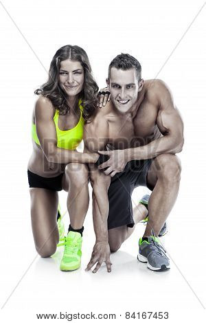 Beautiful Young Sporty Couple Posing And Showing Muscle