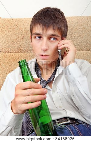 Teenager With A Beer And Cellphone