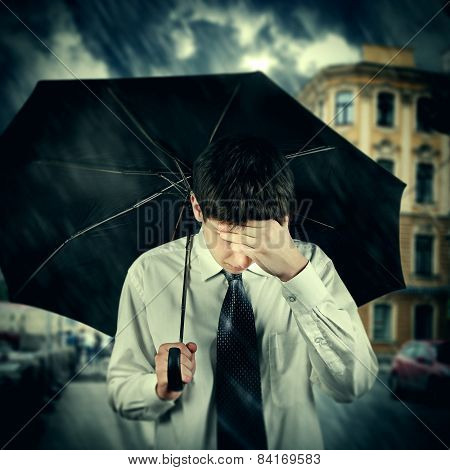 Sad Man Under The Rain