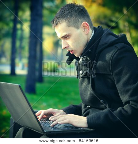 Man With Laptop At The Park