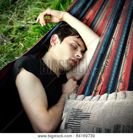 Young Man Sleeping Outdoor