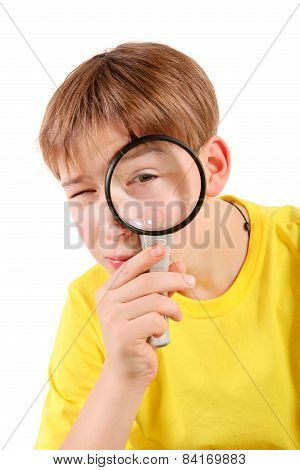 Teenager With Magnifying Lens