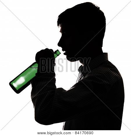 Young Man Drink A Beer