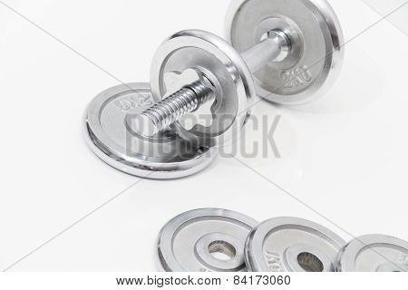 Gray Dumbbells And Loose Weights