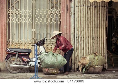 Women with baskets on the street of Hanoi