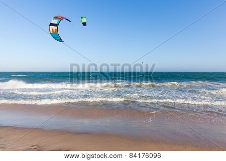 Kiters ride on the waves at Mui Ne beach