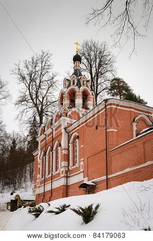 Church from red bricks in winter.
