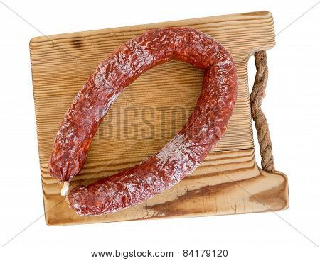Chorizo Sausage And Wooden Board Isolated As Cut