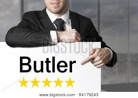 Businessman Pointing On Sign Butler Five Stars
