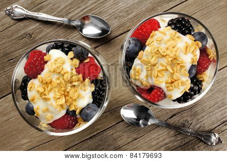 Mixed berry granola and yogurt parfaits above view
