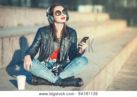 Hipster Beautiful Girl In Leather Jacket And Glasses Listening Music