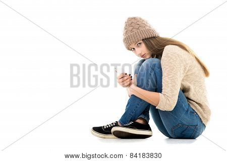 Teenage Girl Holding Cell Phone Looking Scared