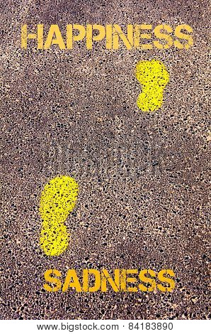 Yellow Footsteps On Sidewalk From Sadness To Happiness Message. Concept Image