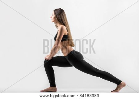 Young Girl Doing Lunge Exercise