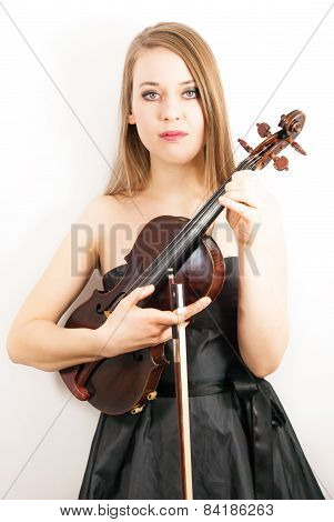 A young beautiful woman with a violin or fiddle