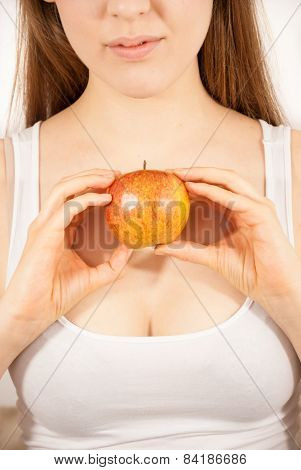 A young beautiful girl with an apple