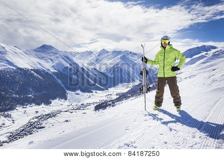 Young men with ski on a mountain winter resort