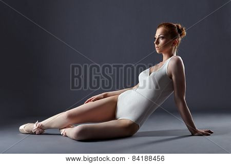Pretty red-haired ballerina in shimmering leotard
