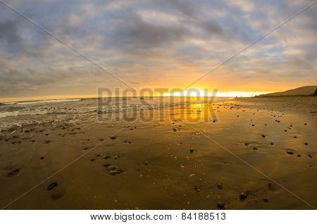 Sunset Over The Coast Of Atlantic Ocean