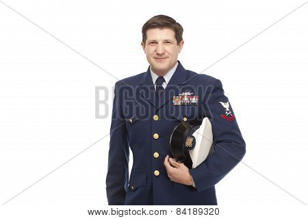 Coast Guard Serviceman Posing Against White Background