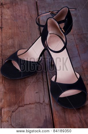 Pair Of Tango Shoes On Worn Out Wooden Floor