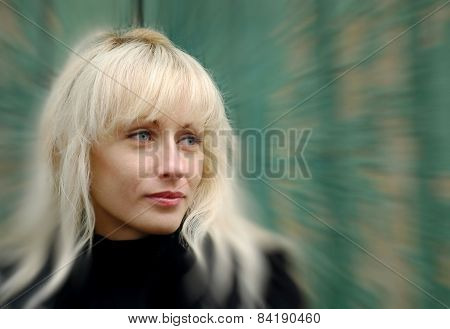 Pretty Blonde On Green Wall Background.soft Bokeh.