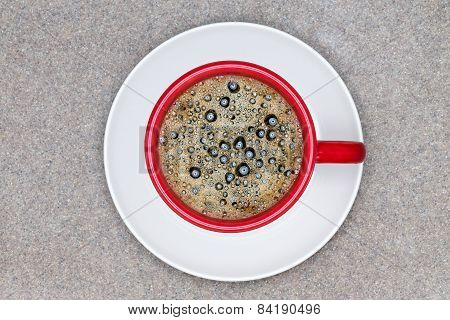 Aerial View Of Black Coffee In Red Cup On A Plate