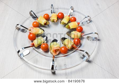 Amuse appetizer on glass scale
