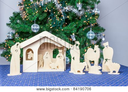 Wooden christmas stable with religious bible figurines