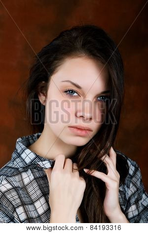 Girl With A Thoughtful Look And Disheveled Hair
