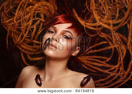 Portrait of a young woman with cockroaches