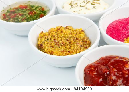 Closeup Of Sauces In White Bowls