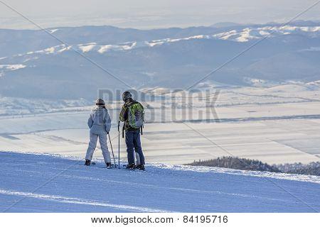 Skiers Enjoying The Panorama