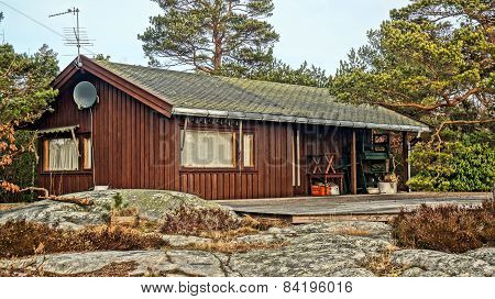 Norwegian Summer Cabin Among Rocks