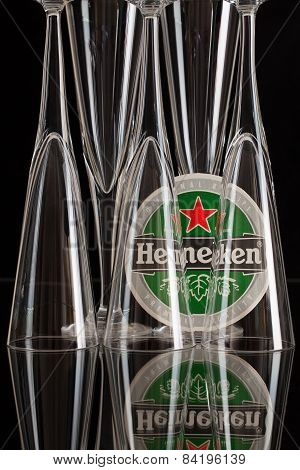 Beermat From Heineken Beer And Three Glasses.