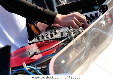dj hands with the audio mixer