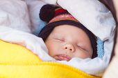 picture of sleeping beauty  - cute little baby sleeping in carriage outdoors - JPG