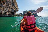 image of kayak  - Caucasian woman is kayaking in sea at Thailand - JPG
