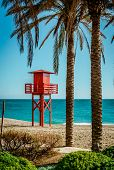 picture of lifeguard  - Lifeguard tower on the beach - JPG