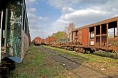 pic of locomotive  - Passing locomotive near the old railway carriages on the siding waiting to cassation or repair - JPG