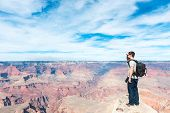 stock photo of grand canyon  - The hikers is enjoying the view of Grand Canyon - JPG