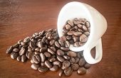 picture of spit-roast  - Roast coffee bean in white mug stock photo - JPG