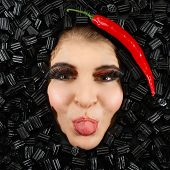 image of licorice  - Beautiful woman face with licorice and chili frame - JPG
